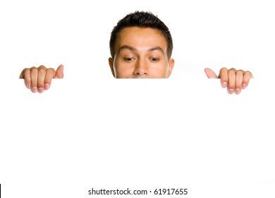 Potrait of a young guy holding blank billboard