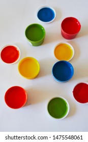 Pots with colorful dye used for fingerpainting. Indoor creative art for kids