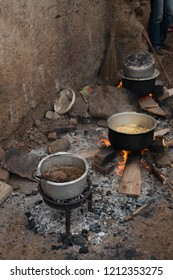 pots of food on wood fire in a traditional african kitchen preparing for a wedding ceremony