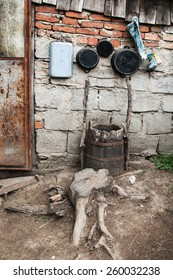 Pots in the nook of the yard of one Romanian village