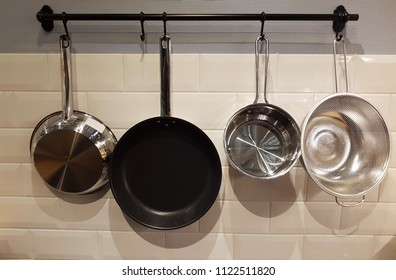 Pots and pans on a rack