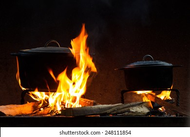 Pots and pans on the stove over a natural fire for cooking