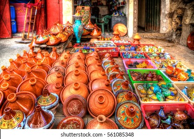 pots of terra cotta and stoneware for the traditional delicious dishes Tajine and Couscous with partially colorful decorative ornamental painting on a market in the Medina of Fes in Morocco in Africa