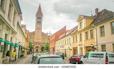 Potsdam, Brandenburg / Germany - 07 25 2016: Crowded with people and tourists Branderburger Street in the historic city center of Potsdam on a summer warm and sunny day.
