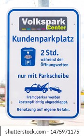Potsdam, Brandenburg/Germany - 24.03.2019: A sign on a supermarket parking lot which says that it is a customer parking lot and one may stand two hours only with parking disk, otherwise is towed off.