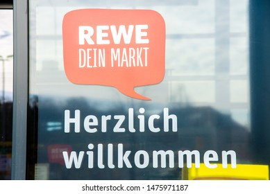 Potsdam, Brandenburg/Germany - 24.03.2019: Sticker to the entrance of the Rewe supermarket on which stands cordially welcome with logo and lettering of Rewe