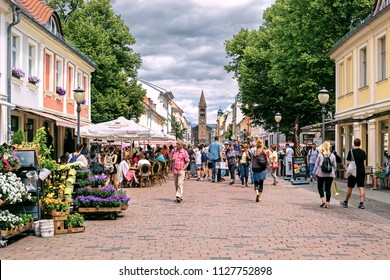 POTSDAM, GERMANY - 30 Jun 2018: Crowded Branderburger Street in the down town of Potsdam on a summer week-end