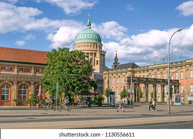 POTSDAM, GERMANY - 30 June 2018: Bundesstrasse street with the Potsdam City Palace which is now Filmmuseum and Nikolaikirche