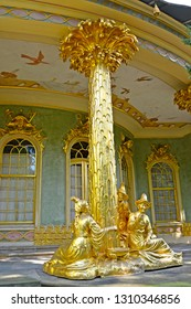 POTSDAM, GERMANY - AUGUST 14, 2017: Gilded sculptural group on a verandah of the Chinese tea lodge. Park of San Sushi