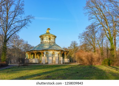 POTSDAM, GERMANY - JANUARY 2018 : Outdoor sunny scenery in front of   Chinesisches Haus Sanssouci, Chinese teahouse, in Sanssouci Park surrounded by winter tranquil natural atmosphere.