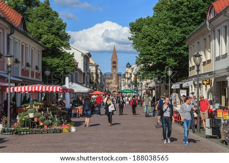 POTSDAM, GERMANY - JUNE 6 : Tourists walking at Brandenburg Street in the old town district of the city on June 6, 2013 in Potsdam, Germany. This street located next to Brandenburg gate of Potsdam.