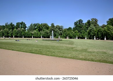 Potsdam, Germany - May 19, 2013: Resting  people on the grass in park Sanssouci