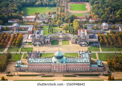 Potsdam, Germany, New Palace in the Sanssouci park in early autumn - aerial view
