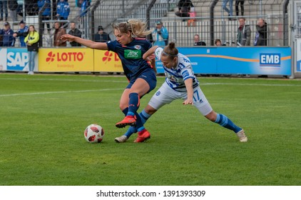 POTSDAM - MAY 5: MSV Duisburg Player Yvonne Zielinski is fighting for the ball with Turbine Potsdam Player Gina Chmielinski  on May 5, 2019 in Potsdam, Germany.