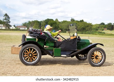 POTTEN END, UK - JULY 27: A veteran Ford motorcar exits the show grounds having given a public display earlier in the day at the Dacorum Steam Fair on July 27, 2014 in Potten End.