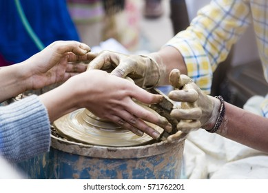 A potter giving pottery making lesson.