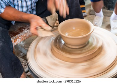 Potter hands making in clay on pottery wheel. Potter makes a pottery on the pottery wheel clay pot.