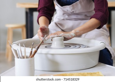 Potter making a dish in his workshop
