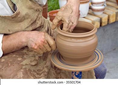 Potter making a pot