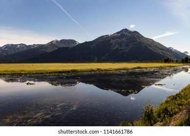 Potter Marsh, wildlife viewing area in the Anchorage area with a view of the Chugach Mountains, Alaska, USA in summertime.