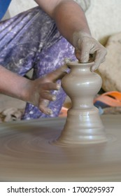 Potter uses traditional wheel to create pottery in a village near  Jodhpur, Rajasthan, India