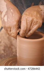Potter at work. Artist shaping a bowl on a pottery wheel
