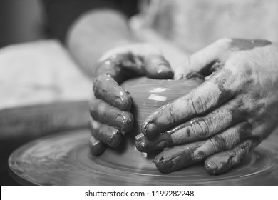 Potter at work. makes a jug out of clay
