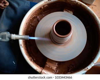 potter at work. production process of pottery. Firing the glaze for the appearance of cracks.