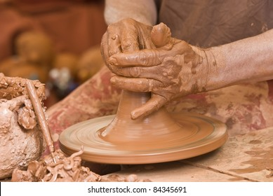 Potter working with clay.