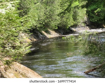 Pottersville, NY / USA - June  1, 2019:  Lazy creek flowing in Adirondack Mountains.