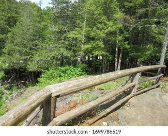 Pottersville, NY / USA - June  1, 2019:  A rustic wood fence in the Adirondack Mountain forest.