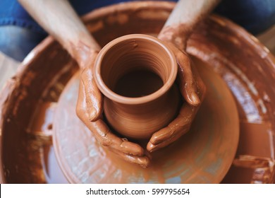 Pottery artisan making fireclay jugs in his atelier