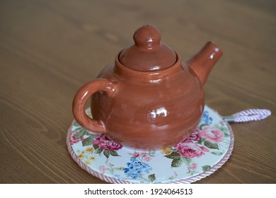 Pottery, a ceramic product with your own hands, made on a potter's wheel, a teapot, a mug, clay.