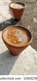 pottery cup filled with Darjeeling tea