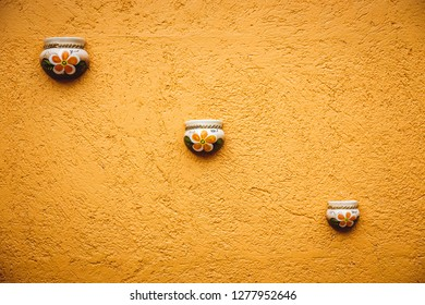 Pottery decorating wall in Yucatan village in Mexico