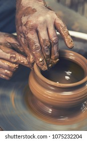 Pottery. The master at the potter's wheel, produces a vessel of clay