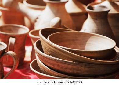 Pottery, plates a cup background