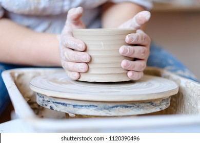 pottery workshop. handmade craft. artisan forming and shaping clay on potter wheel