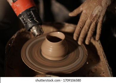 pottery workshop hands girl modeling products