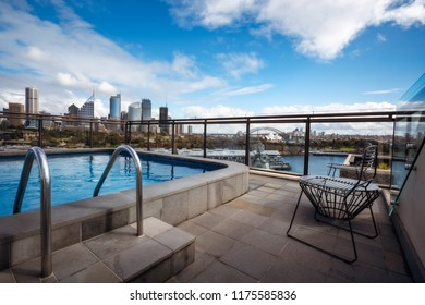 Potts Point, Sydney, Australia - September 03, 2018: Rooftop Swimming Pool in Potts Point on a beautiful sunny morning with gorgeous views of Woolloomoollo Bay and Sydney City Skyline in Australia.