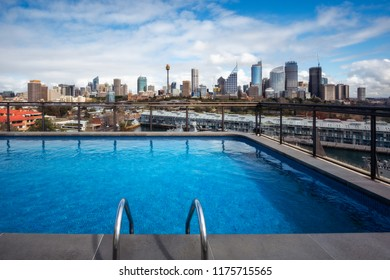 Potts Point, Sydney, Australia - September 03, 2018: Rooftop Swimming Pool in Potts Point on a beautiful sunny morning with gorgeous views of Woolloomoolo Bay and Sydney City Skyline in Australia.