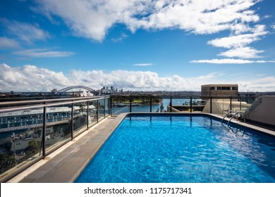 Potts Point, Sydney, Australia - September 03, 2018: Rooftop Swimming Pool in Potts Point on a beautiful sunny morning with gorgeous views of Woolloomooloo Bay and Sydney City Skyline in Australia.