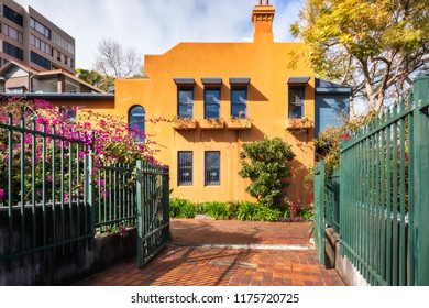 Potts Point, Sydney, Australia -September 03, 2018: The entry to Embarkation Park on a beautiful sunny morning with an interesting building at the end of perspective in Potts Point, Sydney, Australia.