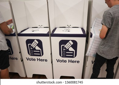 Pottsville, NSW Australia - March 23 2019 : People placing teir vote at a polling station inside of a cardboard booth for an election