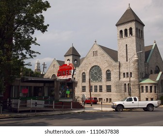POTTSVILLE, PA - JUNE 7, 2015: The Historic Garfield Diner, opened and closed many times over the decades, and the First United Methodist Church on Garfield Square in Pottsville, Pennsylvania.