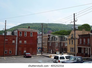 POTTSVILLE, PA - JUNE 8: A view across the small mountain town of Pottsville, Pennsylvania, with the famous Yuengling's beer factory nestled in the mountainside overlooking the city on June 8 2015.