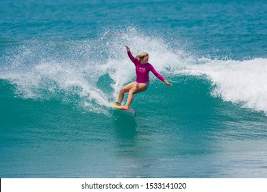 Pottuvil, Eastern Province / Sri Lanka - 05/24/2013: A female surfer riding waves at the east coast surfing town of Arugam Bay in Sri Lanka.