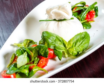 The pouch of dough, cherry tomatoes and mint