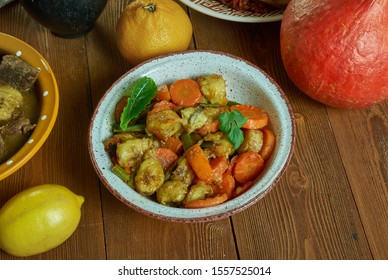 Poulet DG,  delicious chicken and plantain dish, Cameroonian national  cuisine, Traditional assorted African dishes, Top view.