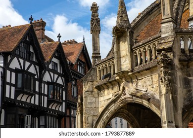 The Poultry Cross with a beautful Tudor era timber-framed building in the background, in the city of Salisbury in the UK.